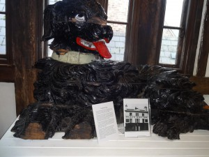 The carved wooden dog from a demolished pub. it was found by chance.