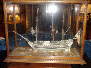 Model boat made from bone with hair for rigging. Made by captive French sailors during a very early 19th Century war between France and Britain.