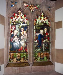 Stained glass windows with a family name